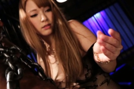 Tia. Tia Asian in libidinous lingerie puts man in chains and strokes penis